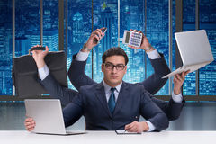 The young businessman in multitasking concept Stock Image
