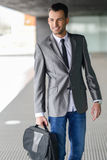 Young businessman near a office building Royalty Free Stock Photos