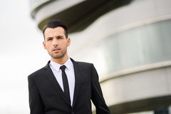 Young businessman near a office building Stock Image