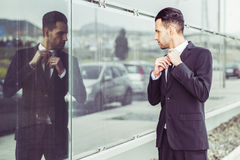 Young businessman near a office building Royalty Free Stock Images