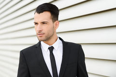 Young businessman near a office building Stock Photo