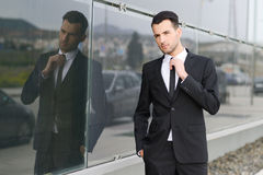 Young businessman near a office building Royalty Free Stock Image
