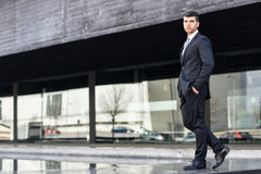 Young businessman near a office building wearing black suit Royalty Free Stock Images