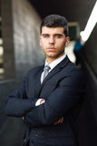Young businessman near a office building wearing black suit Stock Photo