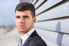 Young businessman near a office building wearing black suit Stock Image