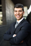 Young businessman near a office building wearing black suit Royalty Free Stock Photo