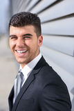 Young businessman near a office building wearing black suit Royalty Free Stock Photography