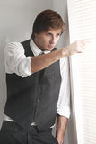 Young businessman near the window Royalty Free Stock Image