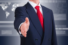 Young businessman offering to shake hands stock photos