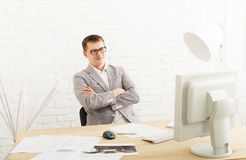 Young businessman in office with computer Royalty Free Stock Image