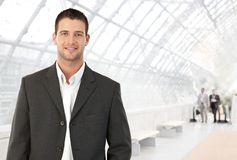 Young businessman in office lobby Stock Image