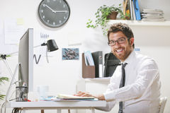 Young businessman in office looking at camera. Royalty Free Stock Photography
