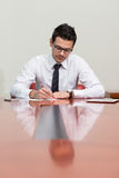 Young Businessman In Office Looking At Paper Stock Images
