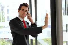 Young businessman at office revolving door Royalty Free Stock Photos