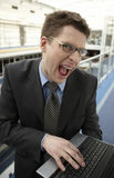 Young businessman office space smile laptop Royalty Free Stock Photos