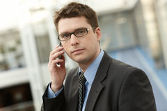 Young businessman in office space talking Stock Images