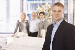 Young businessman in office with team Royalty Free Stock Images