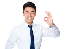 Young businessman with ok sign gesture Stock Image