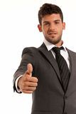 Young businessman OK symbol gesture, isolated. On white background. Focused on hand royalty free stock images