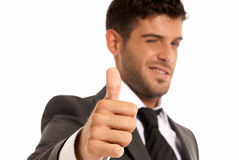 Young businessman OK symbol gesture, isolated. On white background. Focused on hand stock photos