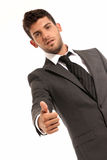 Young businessman ok symbol gesture, isolated. On white background. Focused on hand Royalty Free Stock Photos