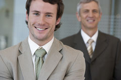 Young businessman with older c Stock Image
