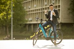 Free Young Businessman On The Ebike Received Great News By Mobile Phone Royalty Free Stock Photography - 183285427