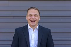 Young businessman having a good laugh royalty free stock images