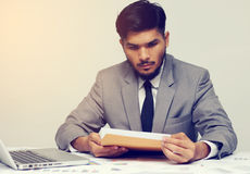 Young businessman opening business report document Royalty Free Stock Images