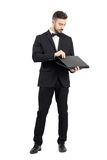 Young businessman opening laptop Royalty Free Stock Photography