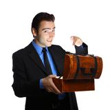 Young businessman opening the treasure box Royalty Free Stock Photos