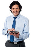 Young businessman operating tablet device Stock Image