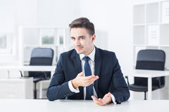 Young businessman opposite to his boss Royalty Free Stock Photos