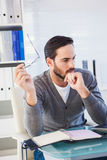 Young businessman organizing his schedule at his desk Stock Photography
