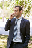 Young businessman is out of office in a field Stock Photo