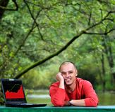 Young businessman outdoor working on laptop Royalty Free Stock Photography