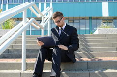 Young businessman outdoors. Young businessman in suit against modern building Stock Image