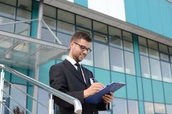Young businessman outdoors. Young businessman in suit against modern building Royalty Free Stock Photography