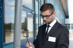 Young businessman outdoors. Young businessman in suit against modern building Stock Photo