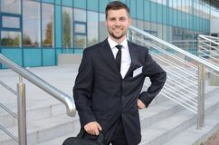 Young businessman outdoors. Young businessman in suit against modern building Stock Images