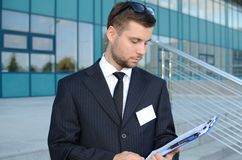 Young businessman outdoors. Young businessman in suit against modern building Stock Photos