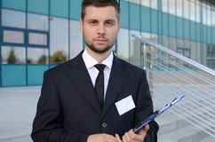 Young businessman outdoors. Young businessman in suit against modern building Royalty Free Stock Photo