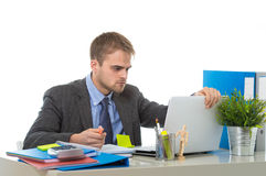 Young businessman overworked looking worried sitting at office computer desk in stress Royalty Free Stock Photo