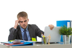 Young businessman overworked looking worried sitting at office computer desk in stress Royalty Free Stock Photography