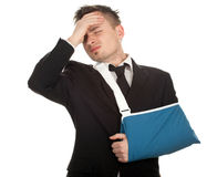 Young businessman with pain and broken hand Royalty Free Stock Photo