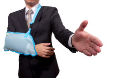 Young businessman with pain and broken hand Stock Photos