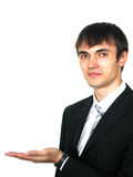 Young businessman with palm up Royalty Free Stock Image