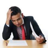 Young businessman with paperwork Stock Photos