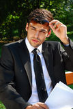 Young businessman in the park Stock Images