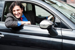 Young businessman parking his car Stock Images